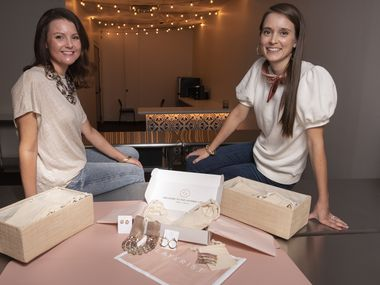 Layerist co-founders Hannah Brown, left, and Kelsey Fraley, with one of their customized signature boxes.