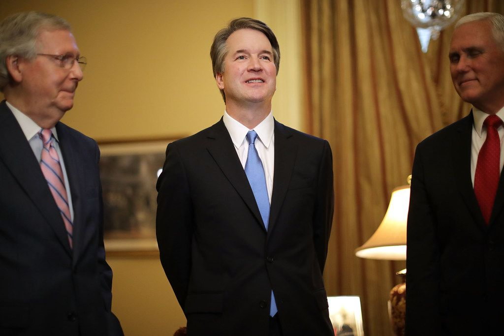 Judge Brett Kavanaugh (Center) poses for photographs with Vice President Mike Pence (right) and Senate Majority Leader Mitch McConnell, R-Ky., before a meeting in McConnell's office in the U.S. Capitol on July 10, 2018, in Washington, D.C. U.S. President Donald Trump nominated Kavanaugh to succeed retiring Supreme Court Associate Justice Anthony Kennedy.