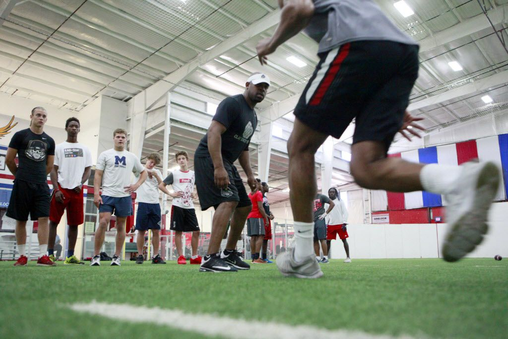 Defensive back football trainer Clay Mack observes the foot technique of young players during a training session with high school and college football defensive backs, on Tuesday, July 12, 2016 at American Indoor Sports in Carrollton. Ben Torres/Special Contributor