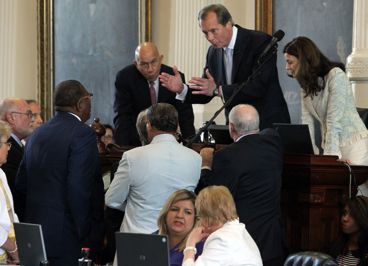 Lieutenant Governor David Dewhurst holds a quick conference while the filibuster is halted for a moment to consider an objection during the final day of the legislative special session as the Senate considers an abortion bill on Tuesday, June 25, 2013.  (Louis DeLuca/Dallas Morning News)
