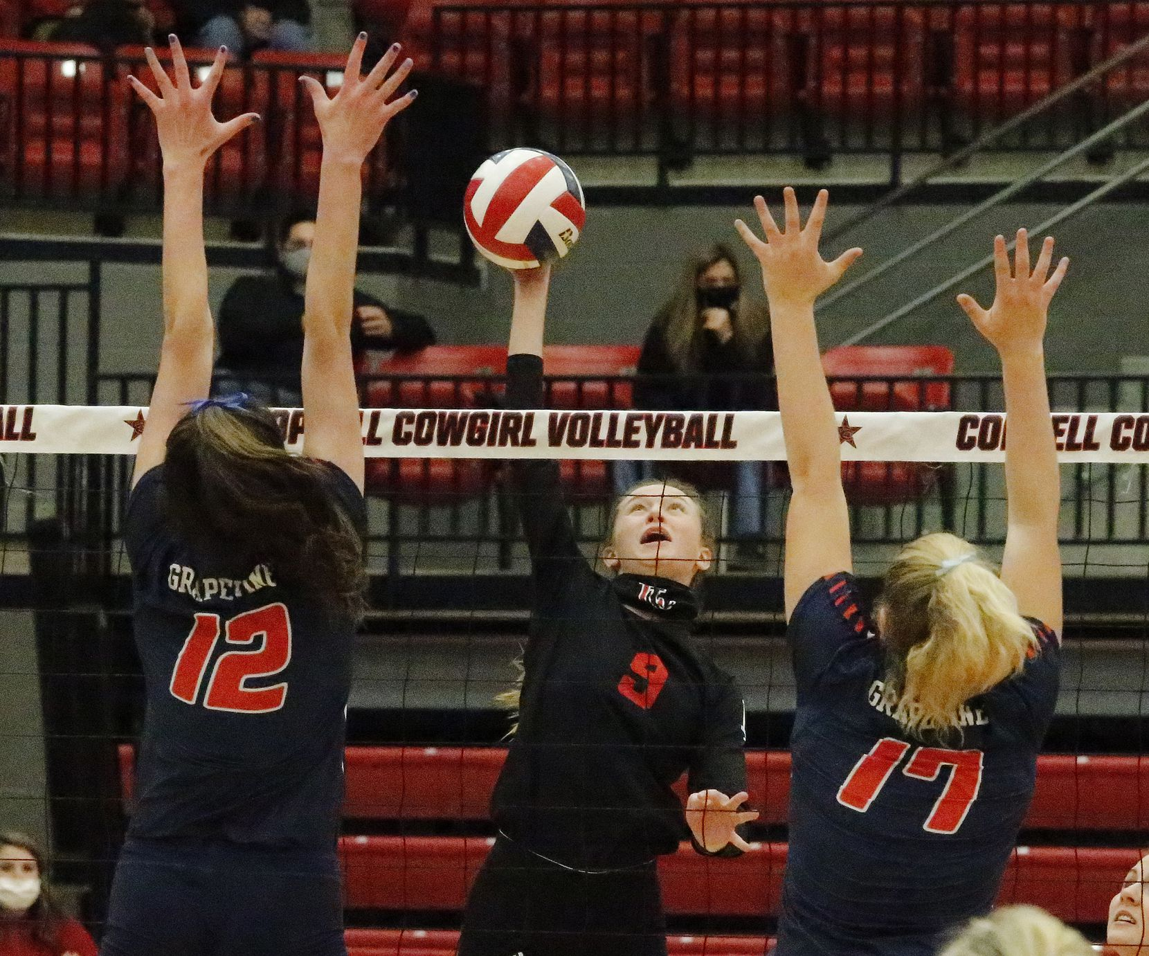 Lovejoy High School setter Averi Carlson (9) gets a hit between Grapevine High School outside hitter Janet DeMarris (12) and Grapevine High School middle blocker Lexi Mayfield (17) during game one as Grapevine High School played Lovejoy High School at Coppell High School in a Class 5A state semifinal match in Coppell on Monday, December 7, 2020.  (Stewart F. House/Special Contributor)