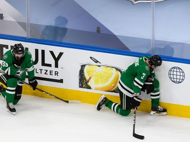 Joel Hanley (39) and John Klingberg (3) of the Dallas Stars react to their loss against the Tampa Bay Lightning during Game Six of the Stanley Cup Final at Rogers Place in Edmonton, Alberta, Canada on Monday, September 28, 2020.