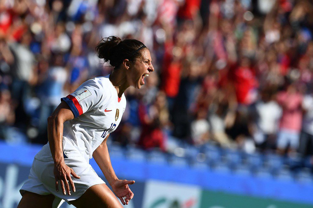 TOPSHOT - United States' forward Carli Lloyd celebrates after scoring a goal during the France 2019 Women's World Cup Group F football match between USA and Chile, on June 16, 2019, at the Parc des Princes stadium in Paris. (Photo by FRANCK FIFE / AFP)FRANCK FIFE/AFP/Getty Images