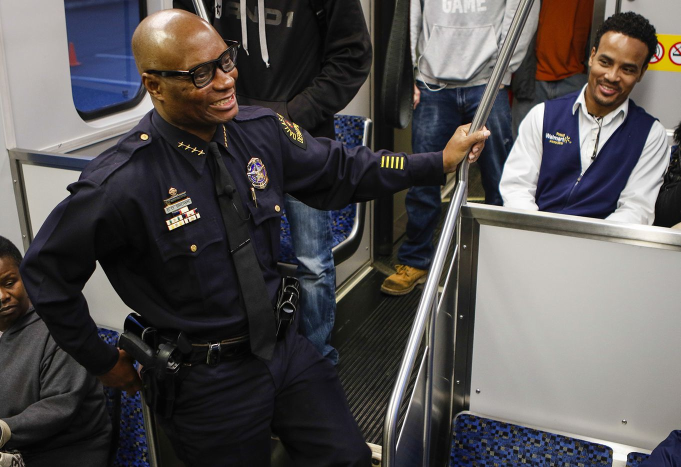 Dallas Police Chief David Brown chats with passengers on a DART train in Dallas as part of a community engagement event on Friday morning, March 20, 2015.