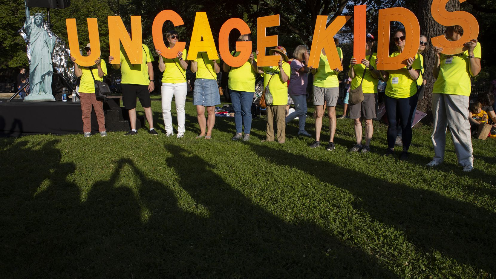 In this July 12, 2019, file photo, protesters hold up a sign that reads 'uncage kids' during a rally in Lafayette Park near the White House where they were calling for and end to immigrant children's detention and family separations. The U.S. government didn't have the technology needed to properly document and track the thousands of immigrant families separated at the southern border in 2018. That's according to a new report by an internal government watchdog.