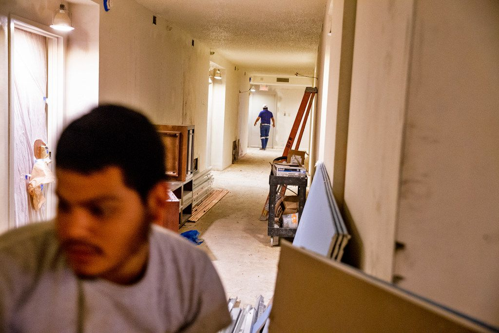 Construction workers renovate a hallway at Renaissance Dallas Hotel on Friday, October 12, 2018. The hotel plans to have all of its rooms completed by 2019.