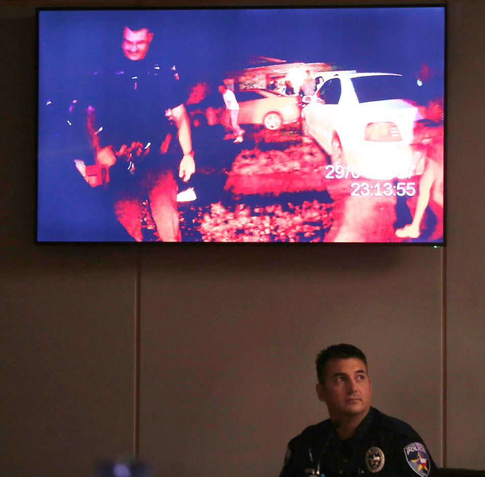 Officer Tyler Gross watched body-cam footage during his testimony on the first day of the murder trial of former officer Roy Oliver. (Rose Baca/Staff Photographer)