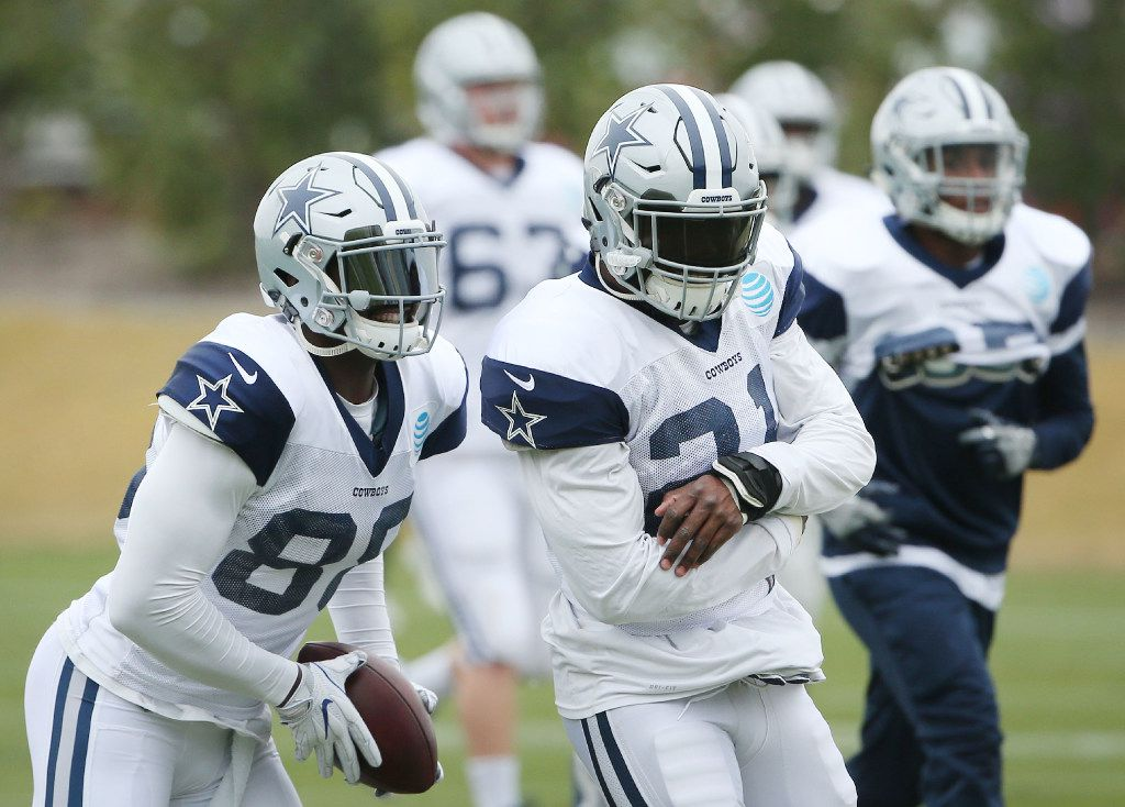 Dallas Cowboys wide receiver Dez Bryant (88) fakes a handoff to running back Ezekiel Elliott (21) in-between drills during team practice at The Star in Frisco, Texas Wednesday December 14, 2016. Cowboys are 11-2 and preparing to play the Tampa Bay Buccaneers on Sunday. (Andy Jacobsohn/The Dallas Morning News)
