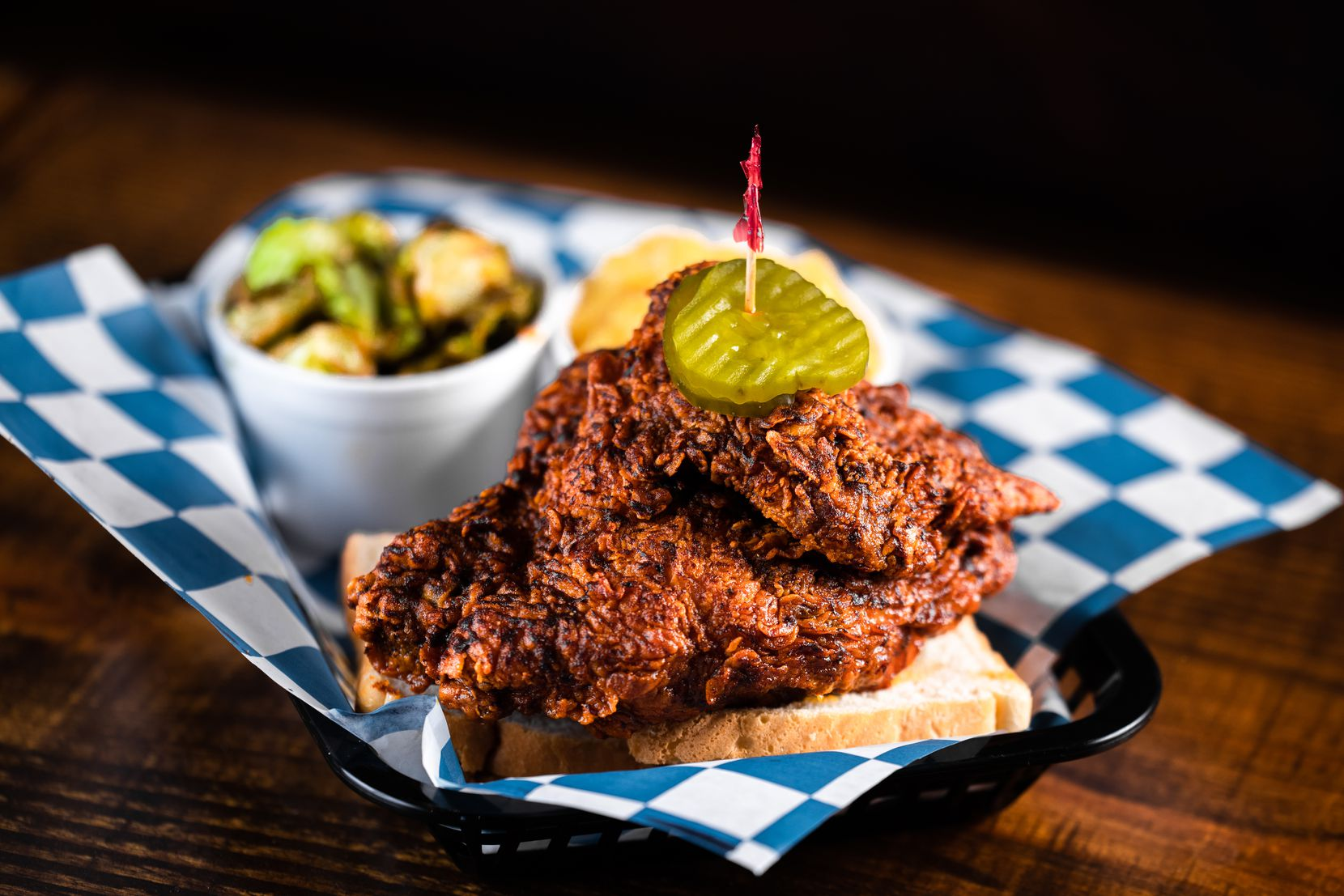 Palmer's Hot Chicken is offering its Haul it Home menu for the holidays this year featuring its Nashville hot chicken served with white bread and pickles.