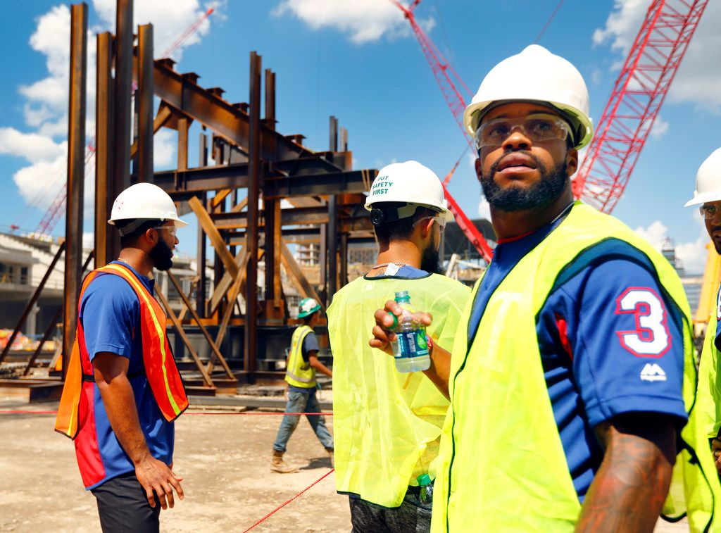 Texas Rangers outfielder Delino DeShields (right) joined shortstop Elvis Andrus (left) and second baseman Rougned Odor (center) on a tour of the field at the new Globe Life Field under construction in Arlington, Texas, Tuesday, September 18, 2018. The Texas Rangers celebrated the One Million Man Hours by providing a barbecue lunch for it's nearly 900 construction workers. Rangers baseball players joined manager Jeff Banister in handing out construction helmet stickers to mark the occasion. They also signed autographs and posed for photos.