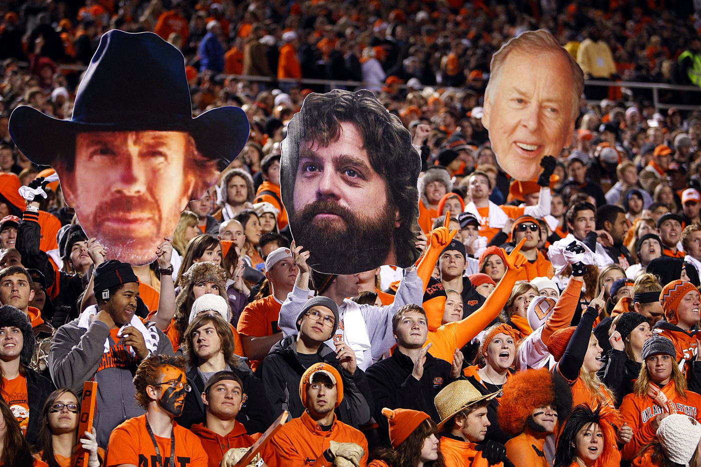 Oklahoma State Cowboys fans sported large cutouts (from left) of actor Chuck Norris, actor Zach Galifianakis and OSU alum T. Boone Pickens before a game with Oklahoma at Boone Pickens Stadium in Stillwate in 2011.