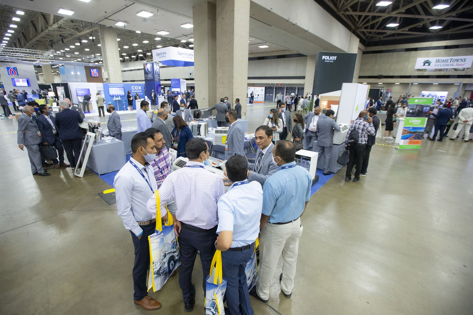 Attendees browse HVAC systems from a vendor at the Asian American Hotel Owners Association convention in Dallas.