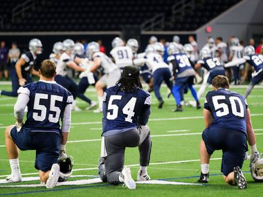 Dallas Cowboys linebackers Leighton Vander Esch (55), Jaylon Smith (54) and Sean Lee (50) watchh from the side during a team OTA practice at The Star on Wednesday, June 5, 2019, in Frisco. (Smiley N. Pool/The Dallas Morning News)