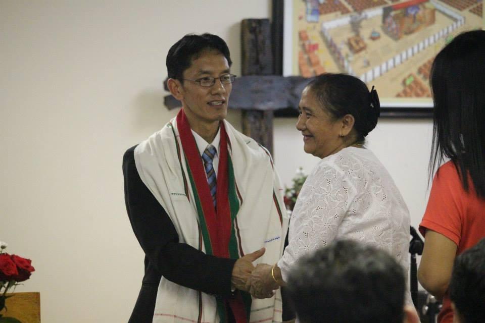 Hau Khai performs a service at his church.