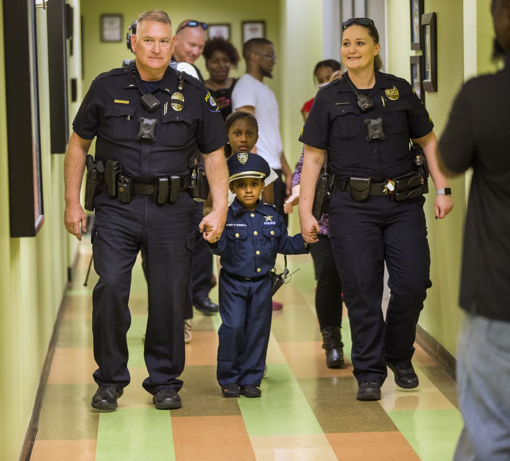 """Four-year-old Ah'Maya Terrell was flanked by Lt. John Densmore and Cpl. Kristine Hill during a tour of the Cedar Hill Police Department on March 26, 2019. At the City Council meeting, she was designated """"chief for a day."""""""