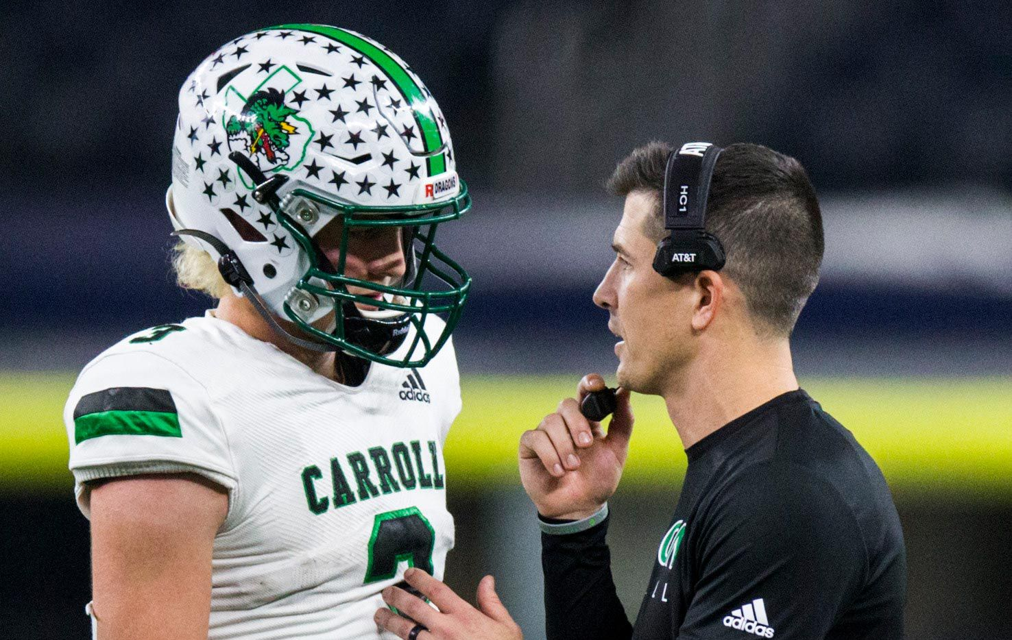 Southlake Carroll quarterback Quinn Ewers (3) talks with head coach Riley Dodge during the fourth quarter of a Class 6A Division I area-round high school football playoff game between Southlake Carroll and DeSoto on Friday, November 22, 2019 at AT&T Stadium in Arlington. (Ashley Landis/The Dallas Morning News)
