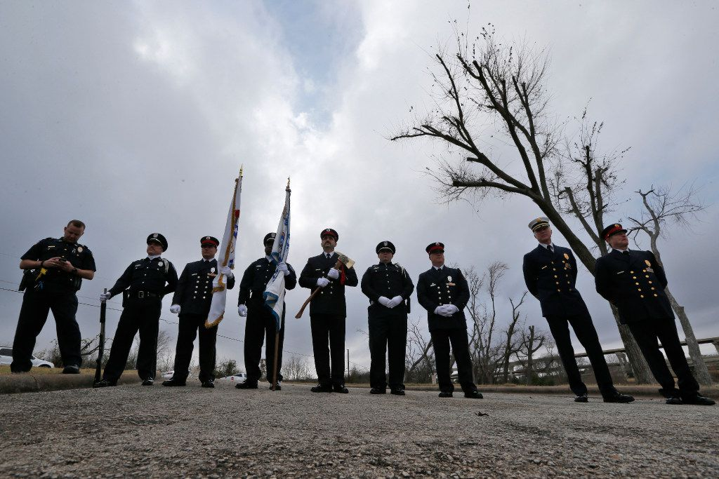 The Garland Police and Fire honor guard stand outside a remembrance ceremony on the anniversary of the tornado that struck last year on the same day killing nine at John Paul Jones Park in Garland, Texas on December 26, 2016.  (Nathan Hunsinger/The Dallas Morning News)