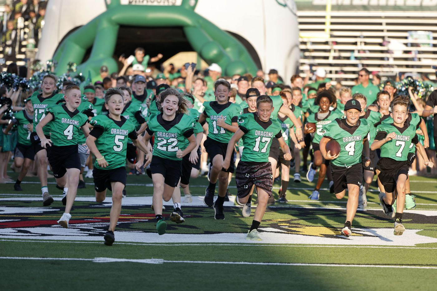 Southlake Youth Football players run onto the field prior to Southlake playing Arlington Martin during a high school football game in Southlake, Texas on Friday, Sept. 17, 2021. (Michael Ainsworth/Special Contributor)