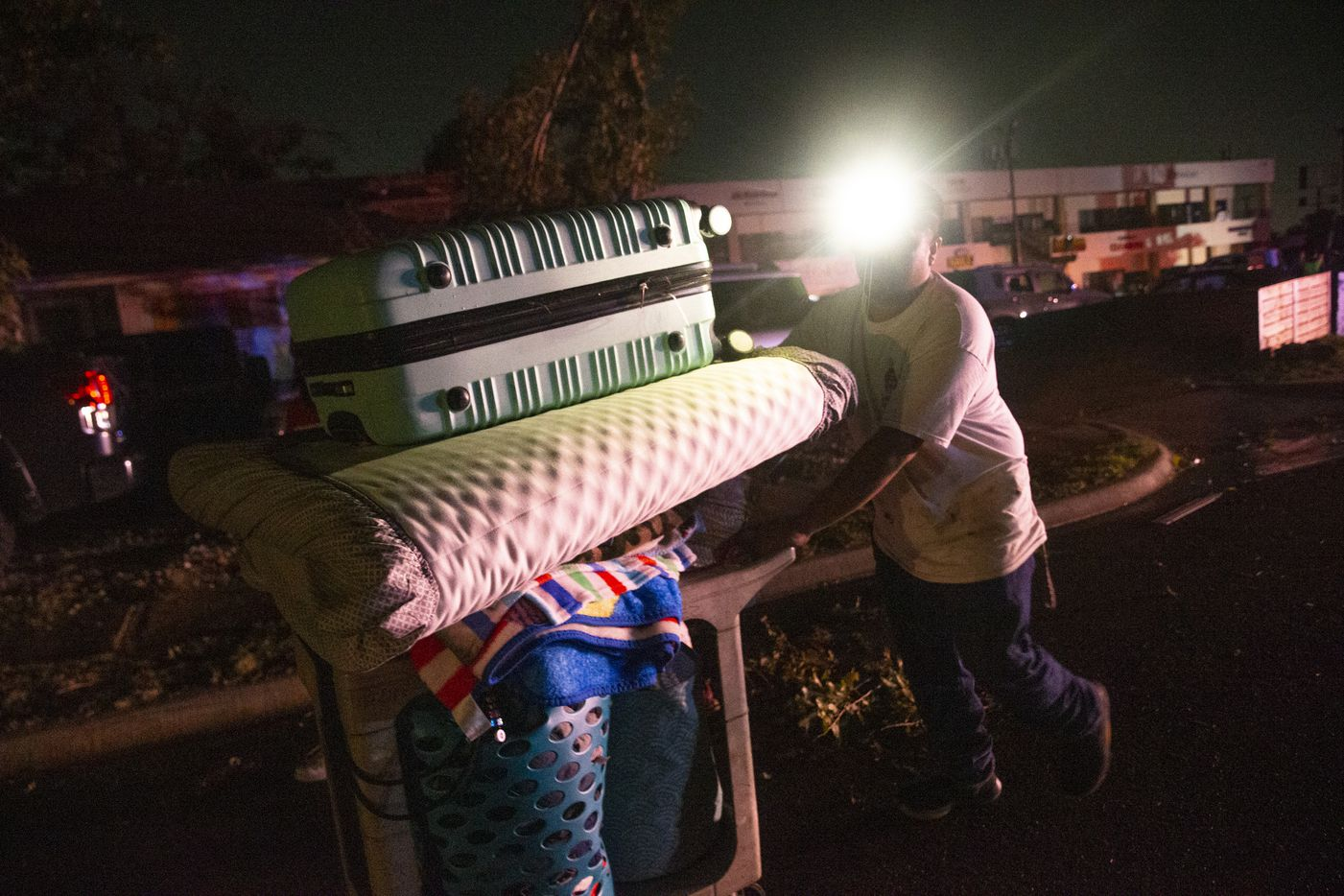 Antonio Gonzalez moves items from his home on Glenrio Lane, which sustained significant damage after a tornado hit parts of northern Dallas on Sunday, Oct. 20, 2019. Gonzalez said he planned to stay with in-laws in Oak Cliff.