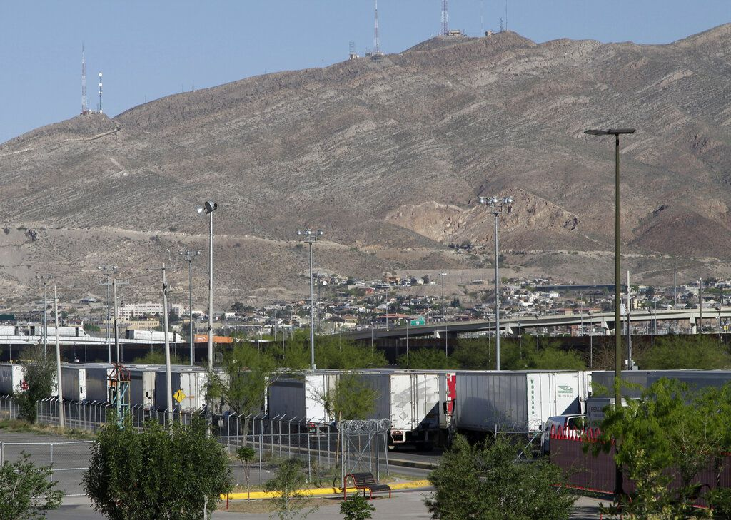 In this April 8, 2019, photo, commercial vehicles wait to cross a port of entry to the U.S. from Juarez, Mexico. Trump's administration has redeployed so many customs agents to process migrants families from Central America that it has caused massive traffic bottlenecks for truckers who are waiting in line for days. (AP Photo/Cedar Attanasio)