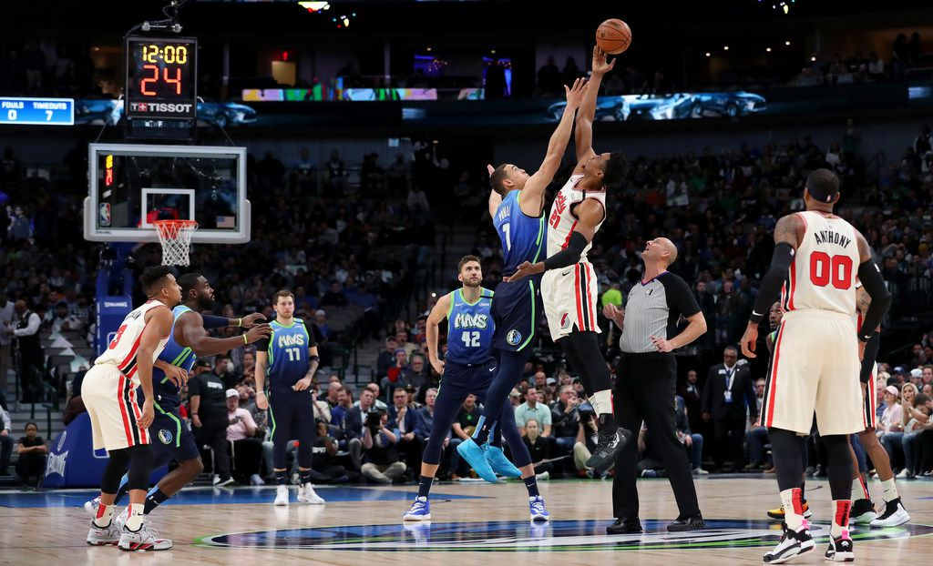 DALLAS, TEXAS - JANUARY 17: Dwight Powell #7 of the Dallas Mavericks squares off against Hassan Whiteside #21 of the Portland Trail Blazers to start the first quarter at American Airlines Center on January 17, 2020 in Dallas, Texas. NOTE TO USER: User expressly acknowledges and agrees that, by downloading and or using this photograph, User is consenting to the terms and conditions of the Getty Images License Agreement. (Photo by Tom Pennington/Getty Images)