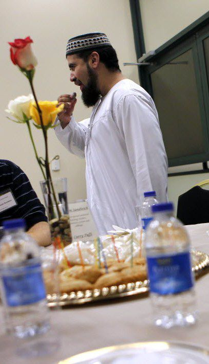 Imam Zia Sheikh breaks a dawn-to-dusk fast during a Ramadan dinner at the Islamic Center of Irving in 2011.