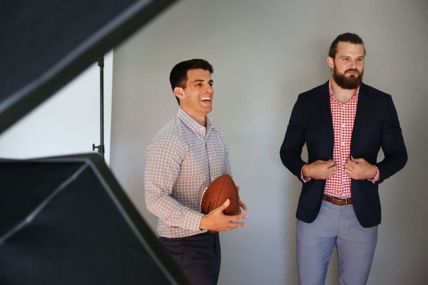 Kevin Lavelle (left), founder and CEO of Mizzen+Main, works with New Orleans Saints punter Thomas Morstead during a  photography session in Dallas. The menswear brand counts Morstead and many other professional athletes among its customers.