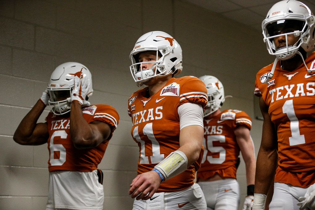 SAN ANTONIO, TX - DECEMBER 31:  Sam Ehlinger #11 of the Texas Longhorns leads the team out of the tunnel before the Valero Alamo Bowl against the Utah Utes at the Alamodome on December 31, 2019 in San Antonio, Texas.