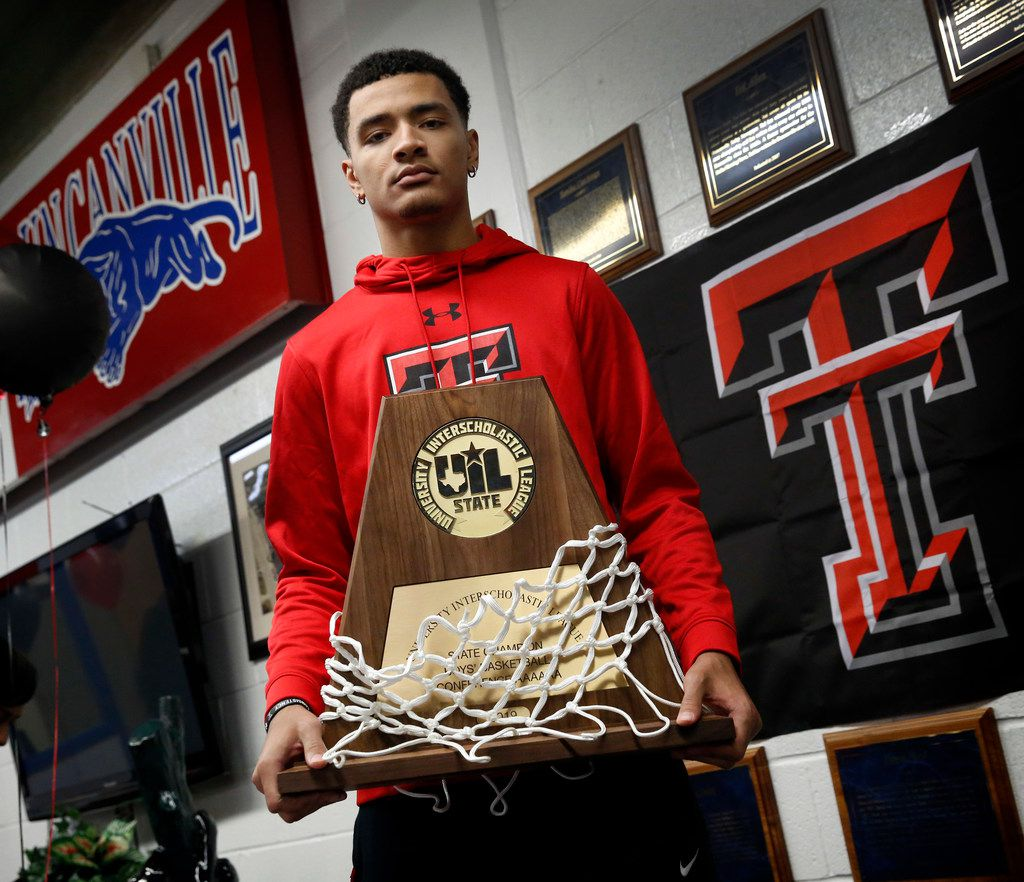 Duncanville boys basketball player Micah Peavy poses with his team's 2019 State Championship trophy after signing a national letter of intent to play for Texas Tech University, Wednesday, November 13, 2019. (Tom Fox/The Dallas Morning News)