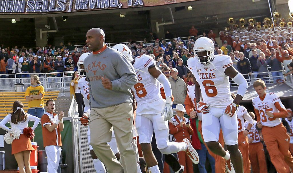 Texas head coach Charlie Strong, left, takes the field with his players against Baylor at McLane Stadium on Saturday, Dec. 5, 2015, in Waco, Texas. (Jae S. Lee/The Dallas Morning News)