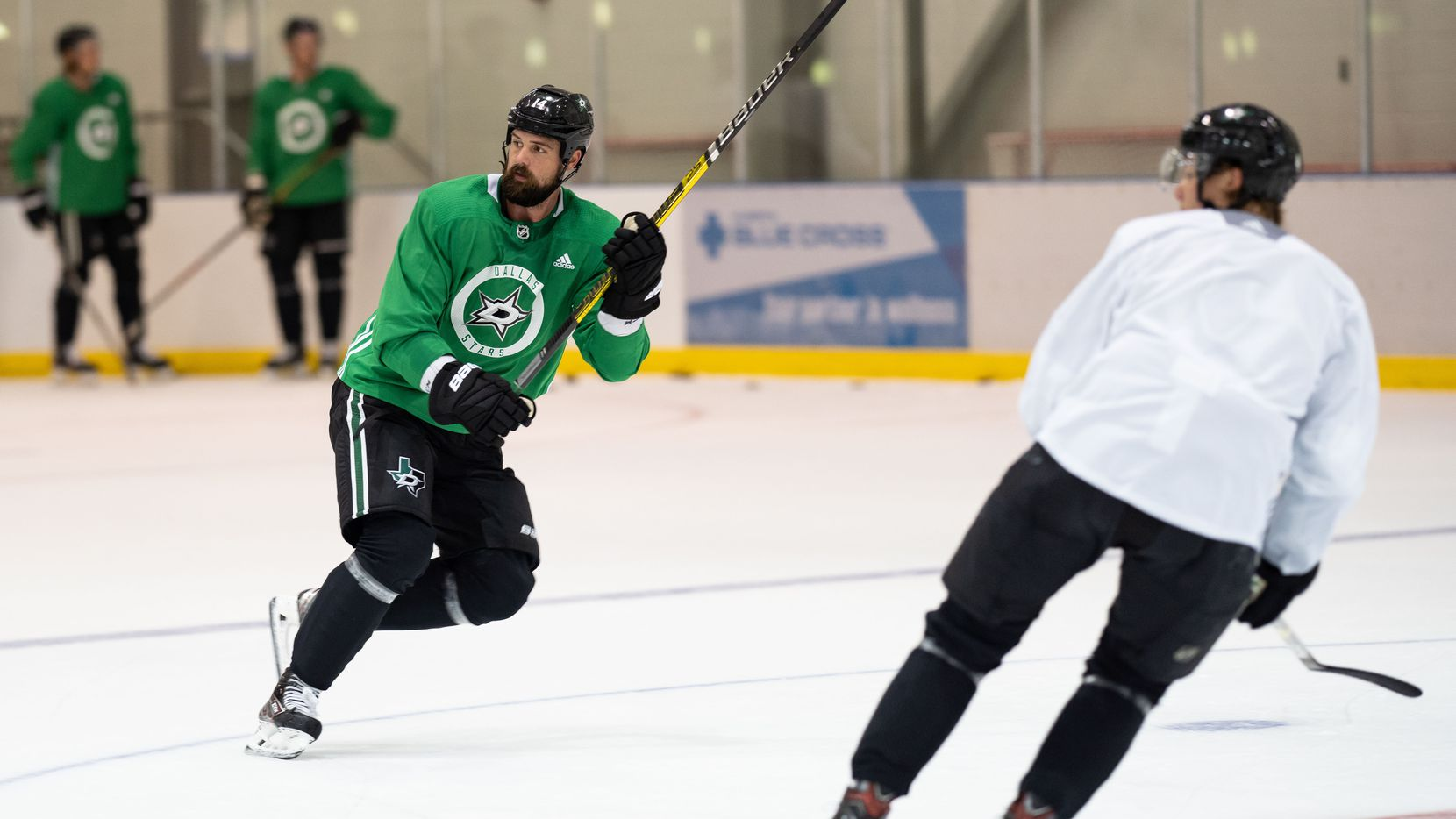 Jamie Benn (green) and Miro Heiskanen get in some practice as the Dallas Stars work out in their 'bubble' in Edmonton, in Alberta, Canada, on July 28, 2020.