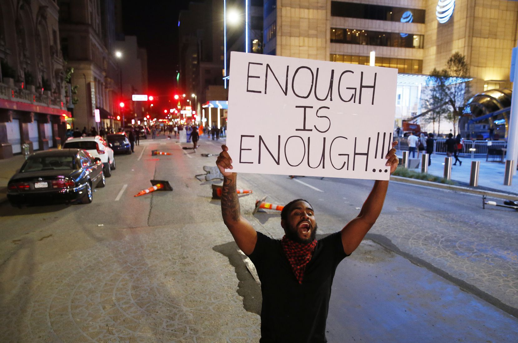 A protester yelled toward police as he walked up Commerce Street in downtown Dallas during a march against <EP>police brutality, days after George Floyd's death. Activists staged peaceful protests in communities throughout North Texas to call for racial justice.
