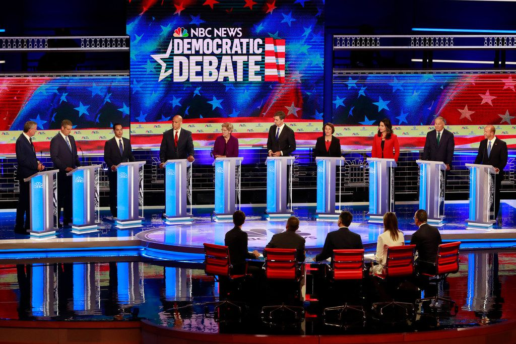 Democratic presidential candidate former Housing and Urban Development Secretary Julian Castro, third from left, answers a question during a Democratic primary debate hosted by NBC News at the Adrienne Arsht Center for the Performing Arts in Miami. (AP Photo/Wilfredo Lee)