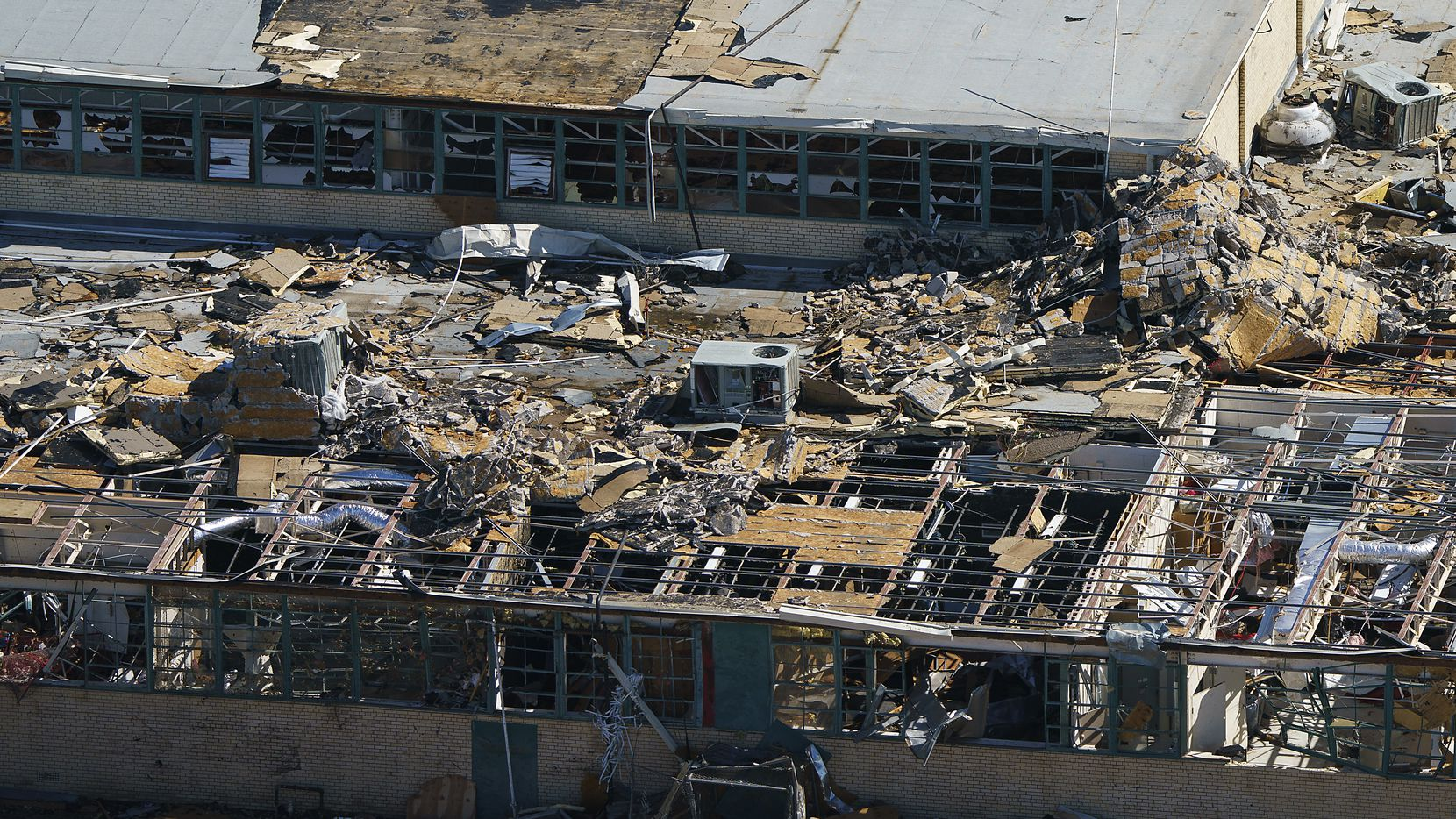 Tornado damage is seen an aerial view of Thomas Jefferson High School on Oct. 21, 2019, in Dallas. (Smiley N. Pool/The Dallas Morning News)