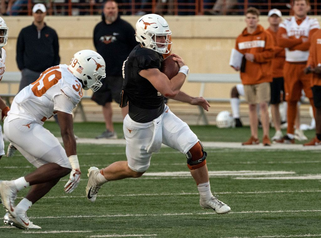 University of Texas quarterback Sam Ehlinger (11) is chased down by defensive back Montrell Estell (39) during the Orange and White spring game held at Darrell K Royal-Texas Memorial Stadium on Saturday, April, 13, 2019, in Austin, Texas.  (Rodolfo Gonzalez/ Special Contributor)