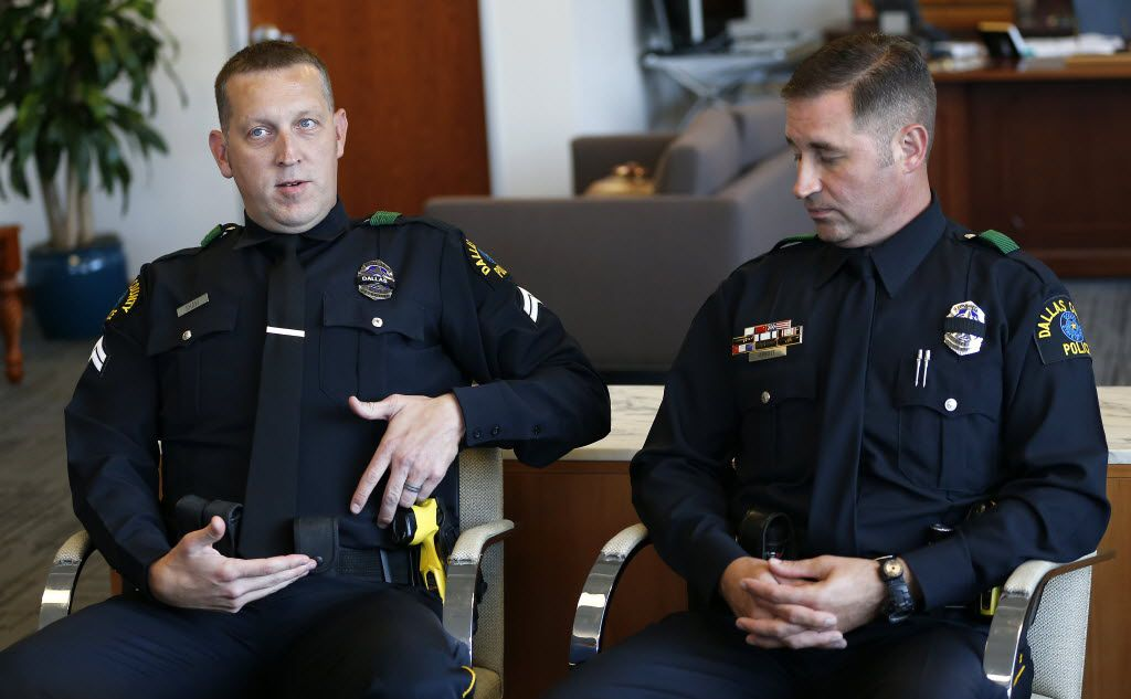 El Centro College police Officer Cpl. Bryan Shaw (left) talks about the location of his injury with Officer John Abbott during a news conference on July 12. Shaw was hit under the vest in his stomach during the deadly shooting.