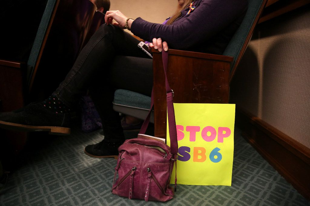 A woman sits with her sign in the overflow room as members of the Senate State Affairs Committee debate and hear public testimony of Senate Bill 6, the transgender bathroom bill, at the Texas State Capitol in Austin on Tuesday, March 7, 2017. The bill would bar transgender people from using the restrooms, locker and changing rooms that correspond to their gender identity in public schools and government buildings. (Rose Baca/The Dallas Morning News)
