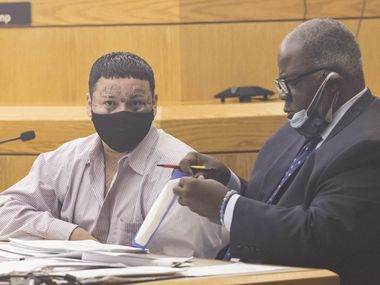 Angel Sanches-Zenteno waits as attorney Kenneth Weatherspoon fixes his face shield before standing trial on a capital murder charge in the 204th District Court on Thursday, July 1, 2021, at Frank Crowley Courthouse in Dallas. Zenteno is accused of killing Martin Ontiveros in 2014. (Juan Figueroa/The Dallas Morning News)