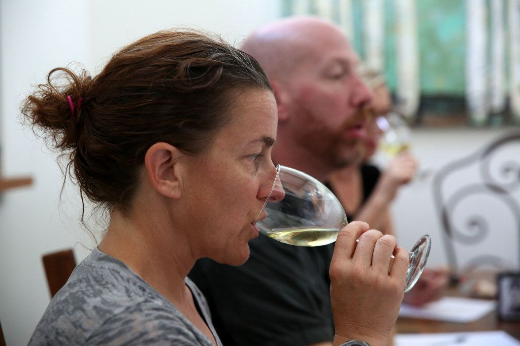 Melissa Monosoff, master sommelier, sips wine during a panel at the home of Tina Danze.