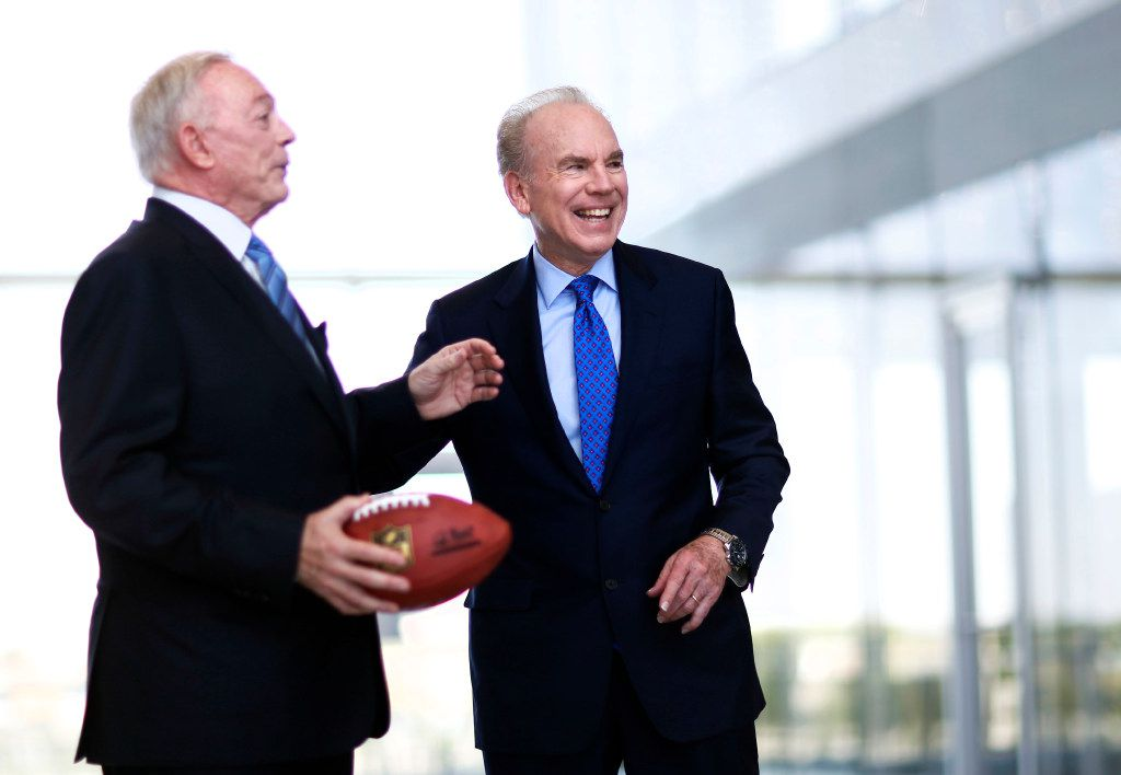 Former Dallas Cowboys quarterback Roger Staubach shares a laugh with Dallas Cowboys owner and general manager Jerry Jones as they break from a portrait shoot at The Star in Frisco on Sunday, May 7, 2017. Staubach and Jones are working together to build a high-rise apartment building at The Star in Frisco. (Vernon Bryant/The Dallas Morning News)