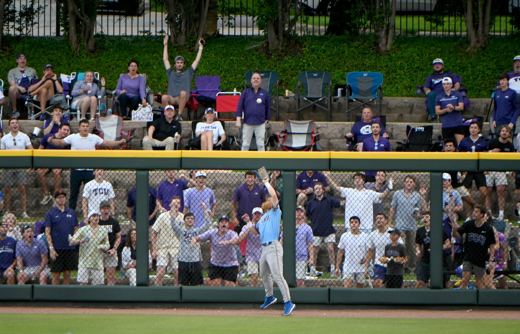 TCU fans react as  McNeese State outfielder Clayton Rasbeary (34) makes a catch at the well in the sixth inning of their game in the Fort Worth Regional NCAA baseball tournament, Friday, June 4, 2021, in Fort Worth, Texas. (Matt Strasen/Special Contributor)
