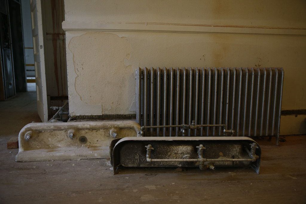 Old fountains and a radiator in the historic Davy Crockett School, which is being converted into in apartments in East Dallas on Oct. 4, 2017.