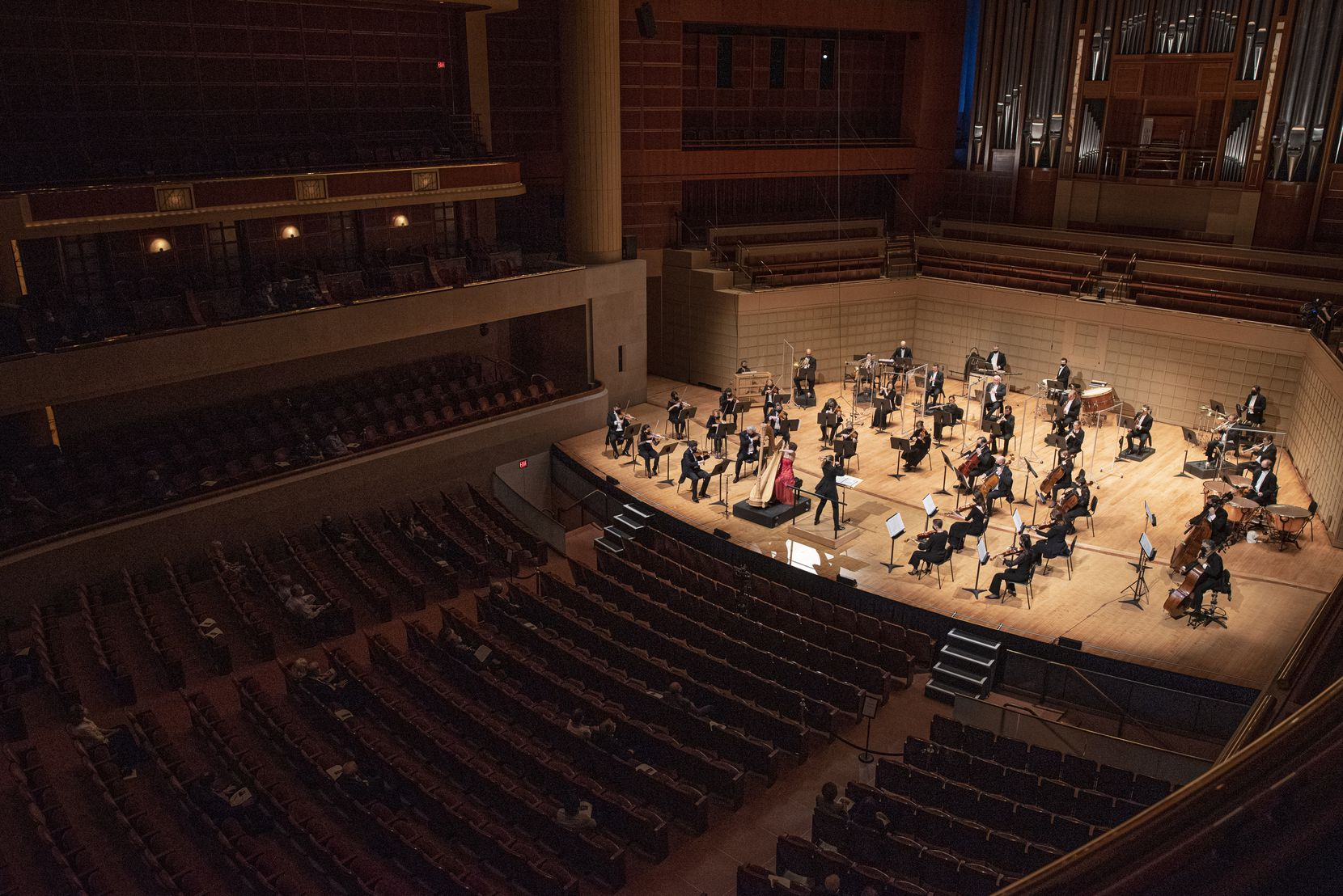 A crowd of under 100 DSO subscribers listen to harpist Emily Levin perform Ginastera's Harp Concerto with principal guest conductor Gemma New and the Dallas Symphony Orchestra at the Morton H. Meyerson Symphony Center in downtown Dallas, Sept. 24, 2020.