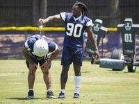Dallas Cowboys defensive end DeMarcus Lawrence (90) pours water on defensive tackle Trysten Hill (72) between conditioning drills during the first practice of the team's training camp on Thursday, July 22, 2021, in Oxnard, Calif.
