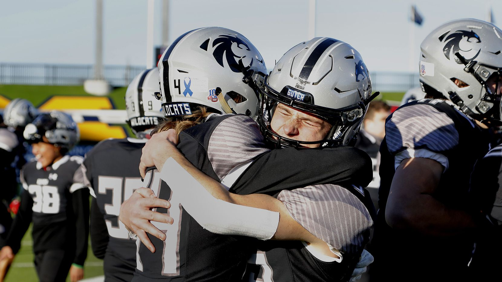 Denton Guyer High School wide receiver Bryson Riggs (34) embraces Denton Guyer High School wide receiver Jake Ausec (25) after a three overtime victory as Prosper High School played Denton Guyer High School in the Class 6A Division II, Region I final at McKinney ISD Stadium in McKinney on Saturday, January 2, 2021.