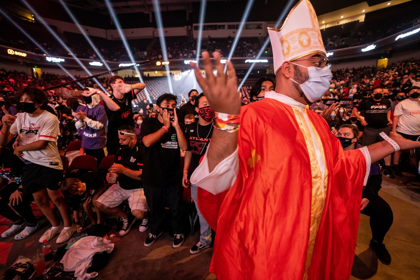 """Gurshaan Arora Dallas, dressed as a pope in honor of Dallas Empires's Indervir """"iLLeY"""" Dhaliwal's nickname, argues with  Atlanta FaZe fans as the two teams compete during the winners final of the Call of Duty league playoffs at the Galen Center on Saturday, August 21, 2021 in Los Angeles, California. The Empire lost to FaZe 0 - 3 in their first match of the day but are still in contention to play in the finals through the elimination finals. (Justin L. Stewart/Special Contributor)"""