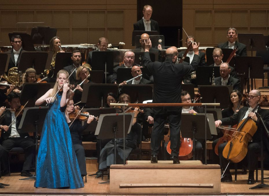 Led by Conductor Jaap Van Sweden, right, Violinist Simone Lamsma performs with the Dallas Symphony Orchestra at the Morton H. Meyerson Symphony Center on Thursday, Sept. 22, 2016.   (Rex C. Curry/Special Contributor)