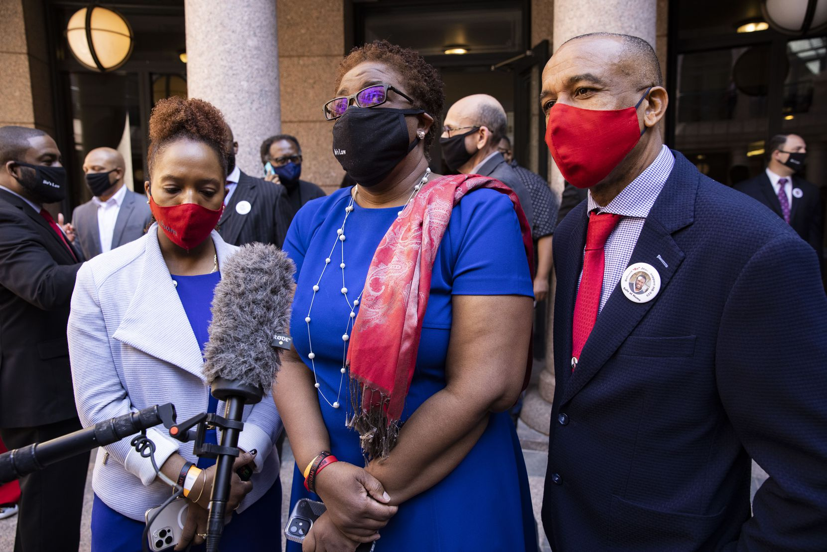Botham Jean's mother, Allison Jean (center), stood with her husband, Bertrum Jean, and daughter Alissa Findley after a March news conference in which Rep. Carl Sherman, D-DeSoto, introduced The Botham Jean Act in Austin. Botham Jean was murdered in his Cedars apartment by a Dallas police officer in September 2018.