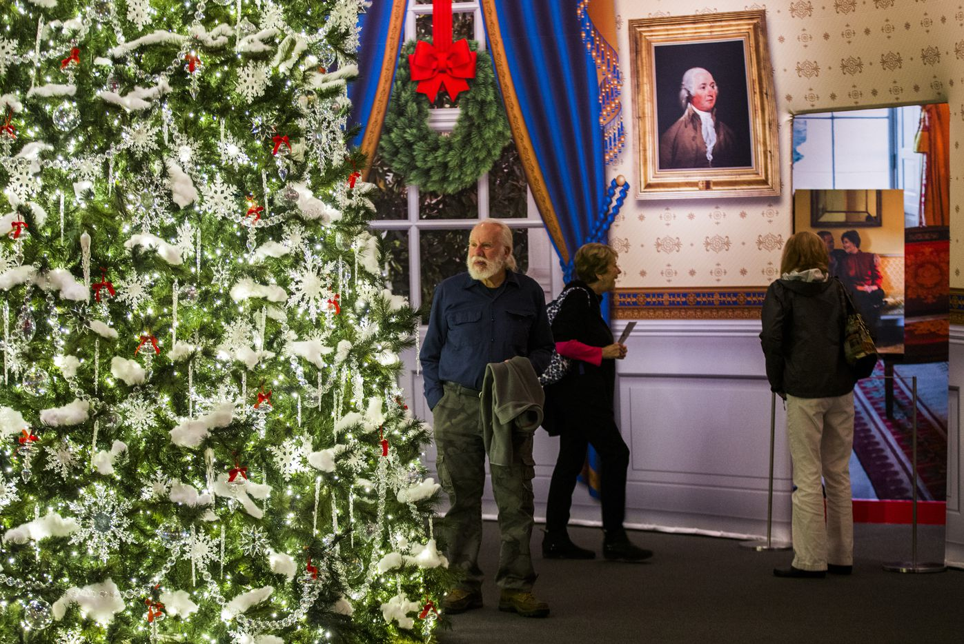 Visitors explore the Blue Room at a Christmas exhibit at The George W. Bush Presidential Center and Library on Thursday, November 15, 2018 on the SMU campus in Dallas. This year's theme is Deck the Halls and Welcome All: Christmas at the White House 2006. (Ashley Landis/The Dallas Morning News)