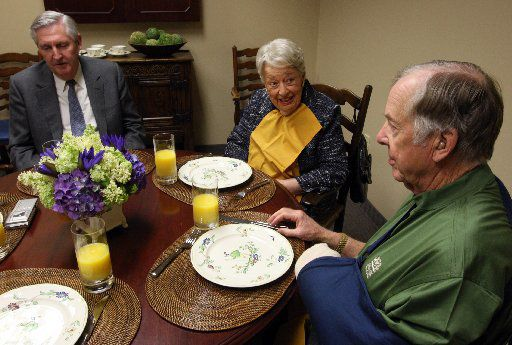 From left:  Dr. Kern Wildenthal, Ebby Halliday and T. Boone Pickens  prepared to practice eating in the dark in 2008.